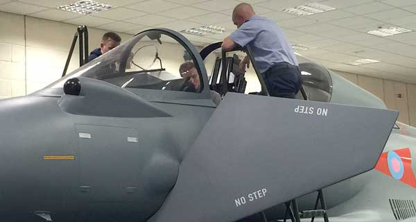 Uniformed services students looking at aircraft